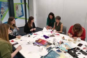 Scientists at an art workshop